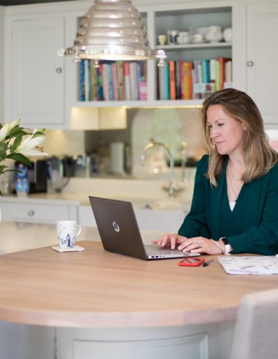 Personal branding woman in modern kitchen on laptop
