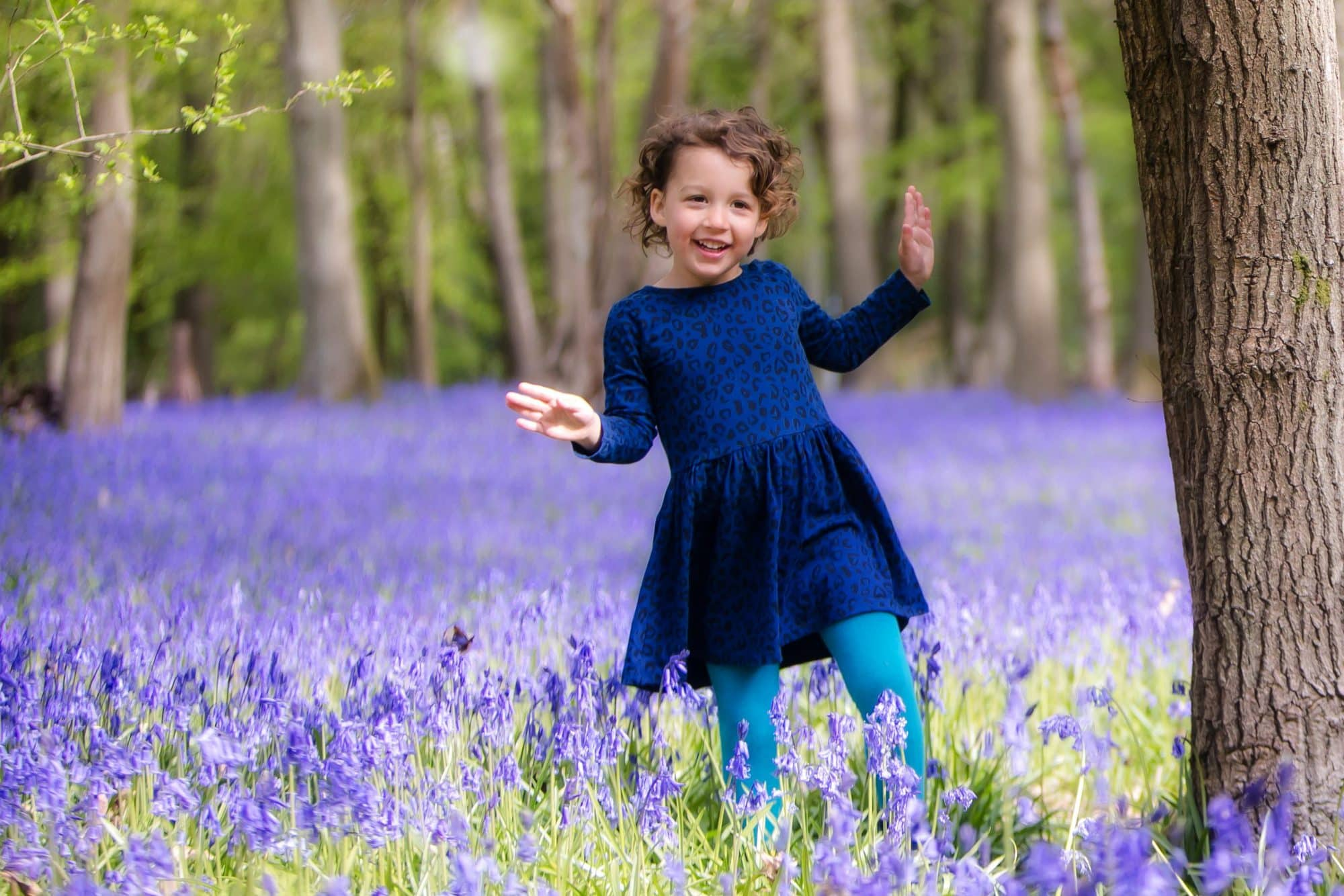 Little girl in bluebells